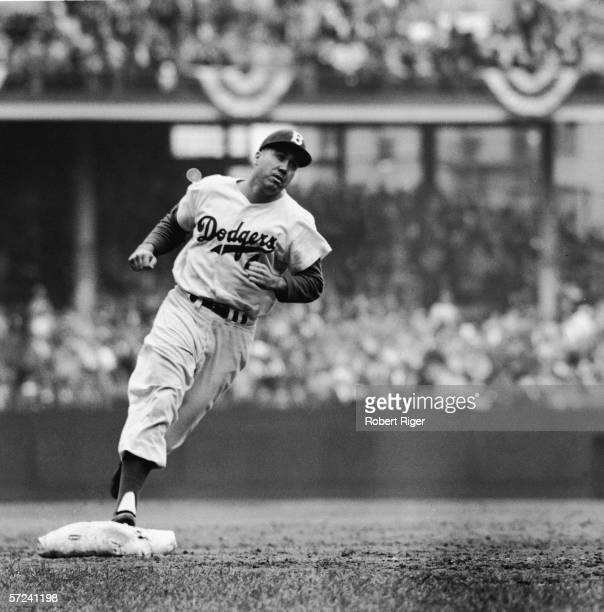 American baseball player Duke Snider runs around the bases during a game 1956