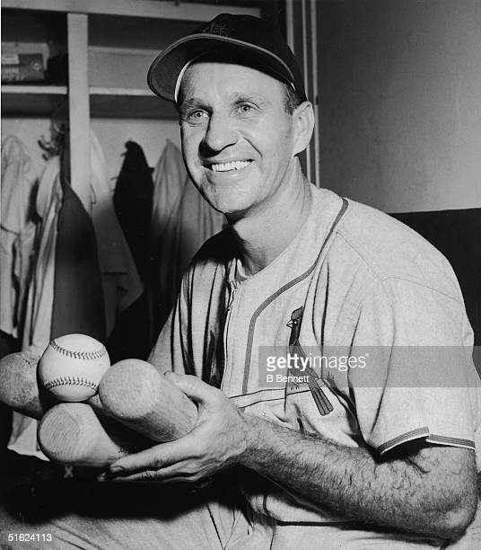American baseball player Enos Slaughter outfielder for the St Louis Cardinals poses with his bats and the ball that represents his 2000th hit New...