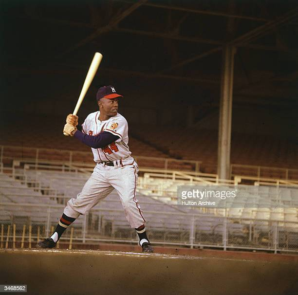 American baseball player Hank Aaron waits for the pitch in an empty stadium