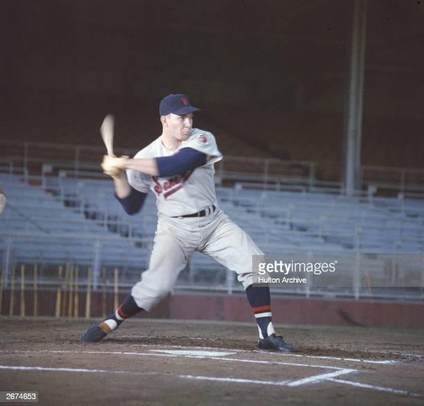 American baseball player Harmon Killebrew, wearing his Washington Senators uniform, swings a bat during practice, c. 1957.
