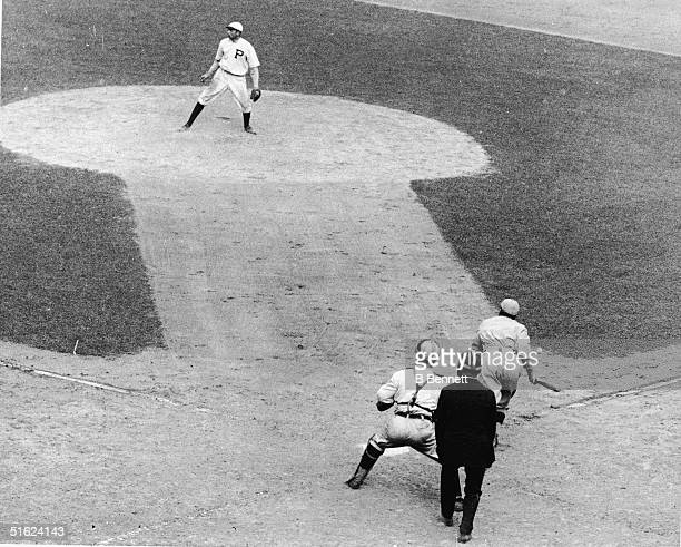 American baseball player Harry Hooper in a Boston Red Sox uniform starts to run after hitting the winning run in the 1915 World Series Philadelphia...