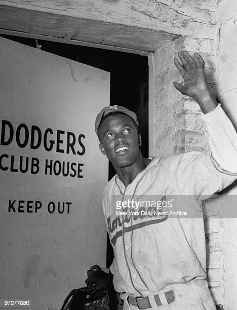Jackie Robinson enters the Brooklyn Dodgers club house as the first black man admitted to the majors
