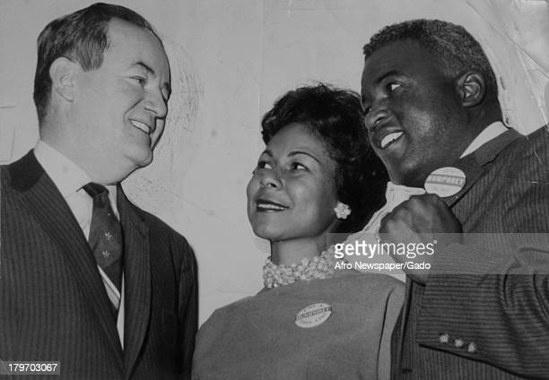 American baseball player Jackie Robinson of the Brooklyn Dodgers and his wife medical practitioner Rachel Robinson meet with Senator Hubert H...
