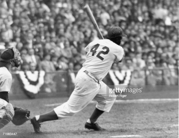 American baseball player Jackie Robinson of the Brooklyn Dodgers at bat during a game, 1940s or 1950s.