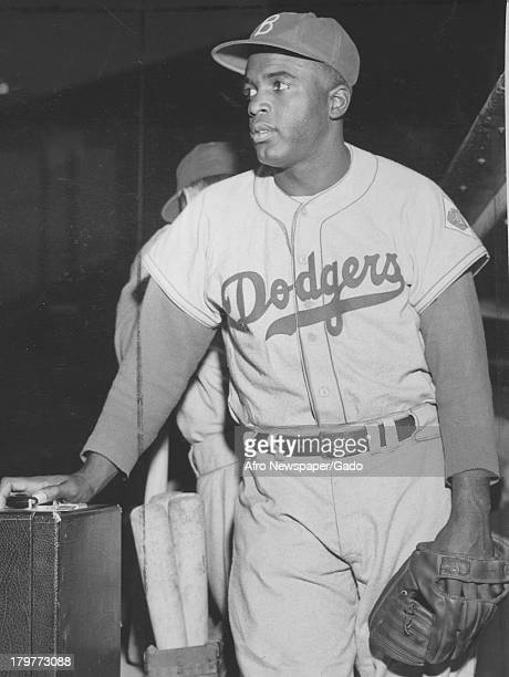 American baseball player Jackie Robinson of the Brooklyn Dodgers prepares for a game 1948