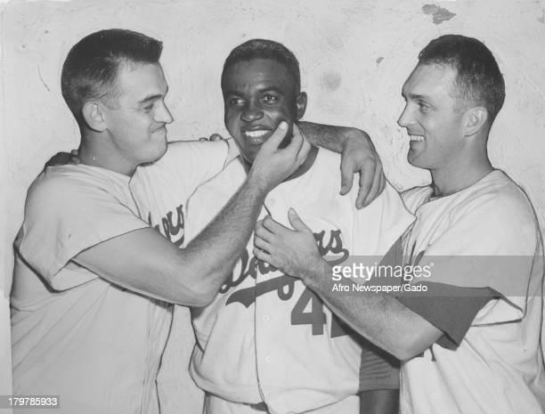 American baseball player Jackie Robinson of the Brooklyn Dodgers is shown with his friends 1949