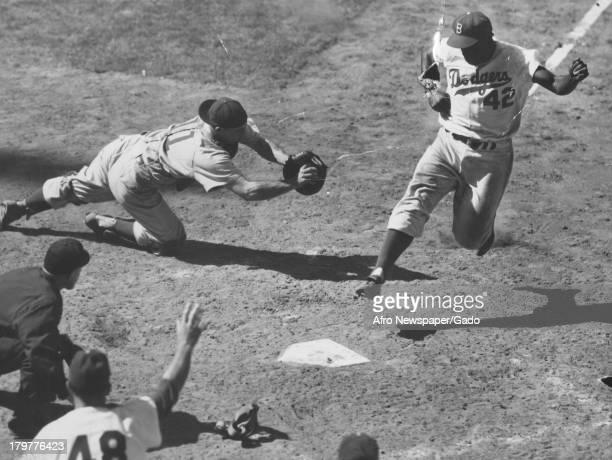 American baseball player Jackie Robinson of the Brooklyn Dodgers played baseball 1949