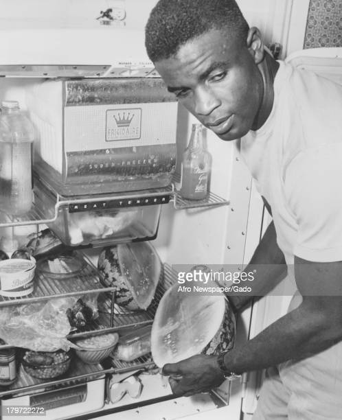 American baseball player Jackie Robinson of the Brooklyn Dodgers keeps the watermelon in fridge 1948