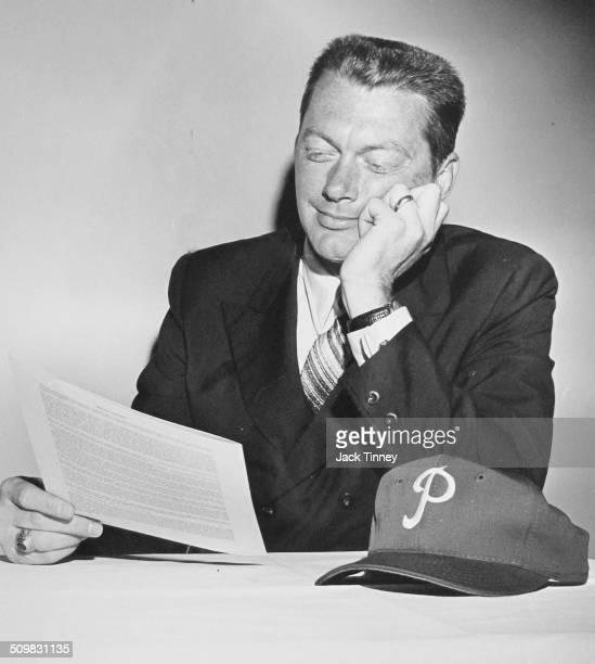 American baseball player Jim Bunning looks over a contract Philadelphia Pennsylvania 1971