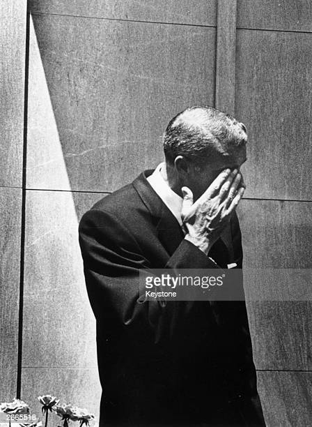 American baseball player Joe DiMaggio wipes a tear from his eye after bursting into tears at the funeral of Marilyn Monroe in Westwood Memorial Park...