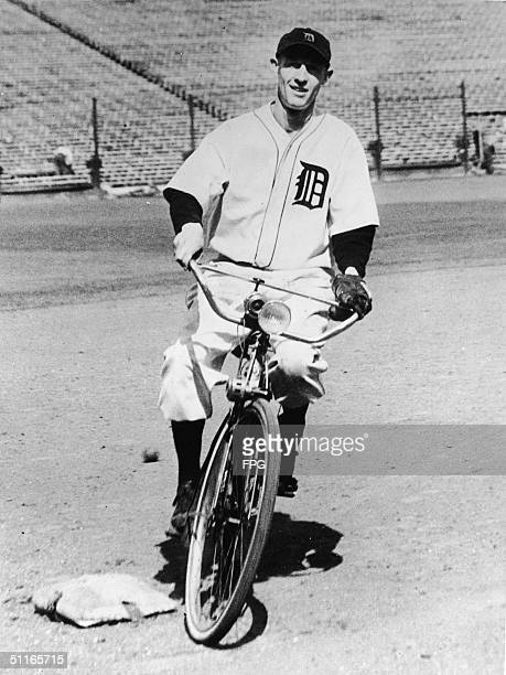 American baseball player Joyner 'JoJo' White outfielder for the Detroit Tigers from 1932 to 1938 rides a bicycle around the bases at Navin Field...