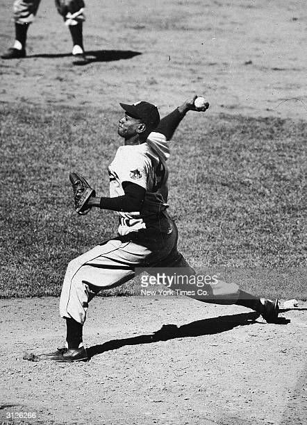 American baseball player Leroy 'Satchel' Paige delivers a pitch on the mound for the St. Louis Browns during a game, early 1950s.