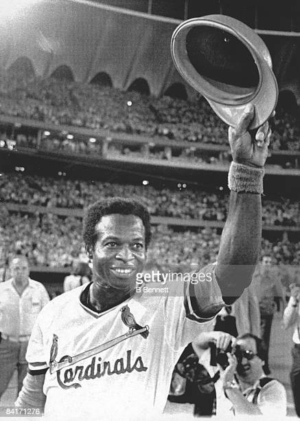 American baseball player Lou Brock of the St Louis Cardinals waves to the crowd after getting his 3000th career hit during a game against the Chicago...