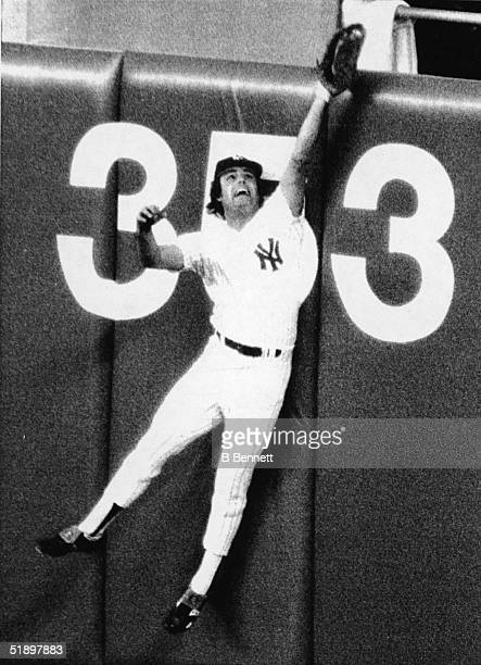 American baseball player Lou Piniella jumps high against the wall to catch a long fly ball in the 2nd inning of a game against the Indians at Yankee...