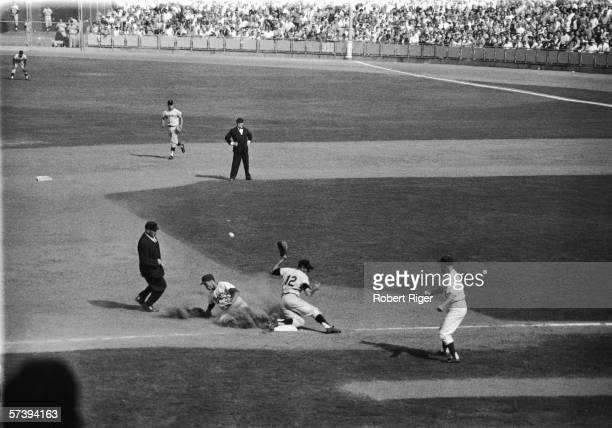 American baseball player Maury Wills of the Los Angeles Dodgers slides into third base as he steals in 104th base for the season during the third...