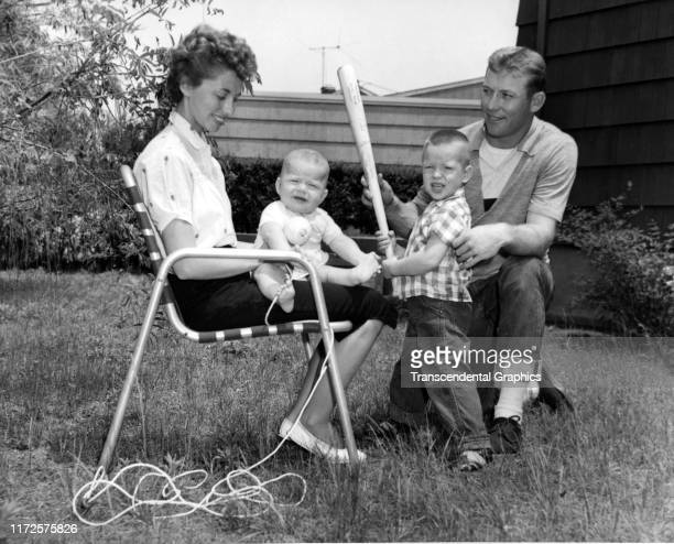 American baseball player Mickey Mantle , of the New York Yankees, poses with his wife, Merlyn Mantle , and their sons David and Mickey Jr in their...