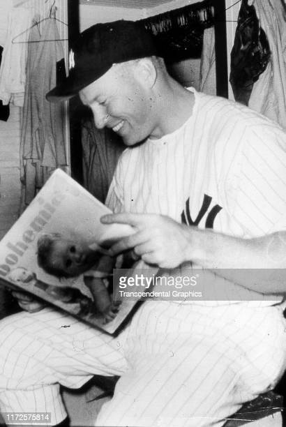 American baseball player Mickey Mantle of the New York Yankees reads a copy of Bohemia magazine early 1950s The original image's caption makes the...