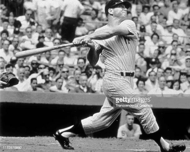 American baseball player Mickey Mantle of the New York Yankees swings a bat during a game at Yankee Stadium New York New York 1961