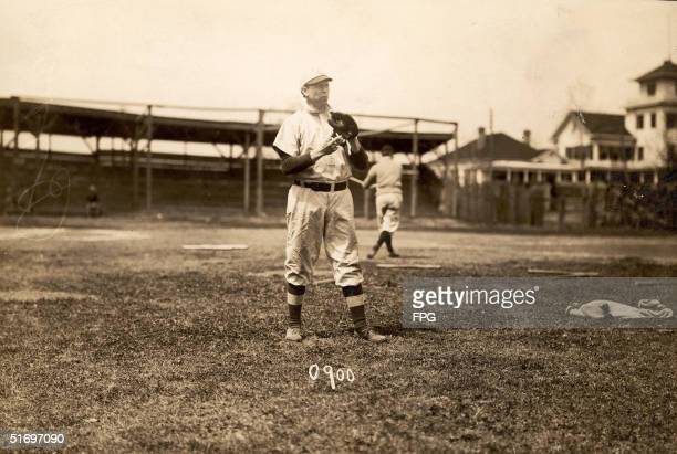 American baseball player Mordecai Brown , pitcher for the Chicago Cubs from 1903 to 1912, prepares to pitch during practice, 1900s. Nicknamed 'Miner'...