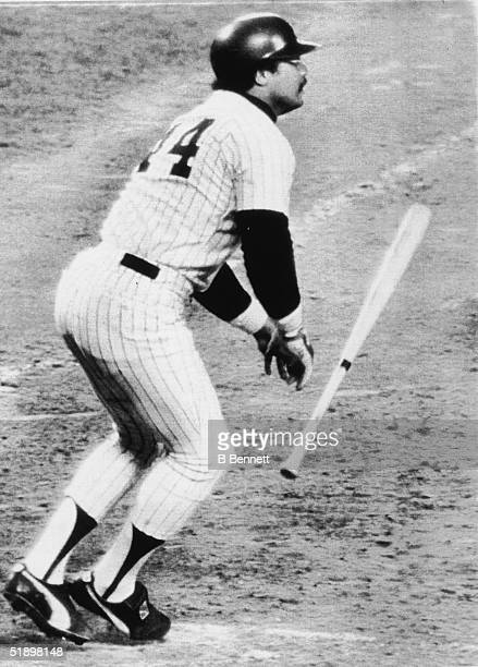 American baseball player Reggie Jackson outfielder for the New York Yankees drops his bat and watches the flight of the ball as he hits his second...