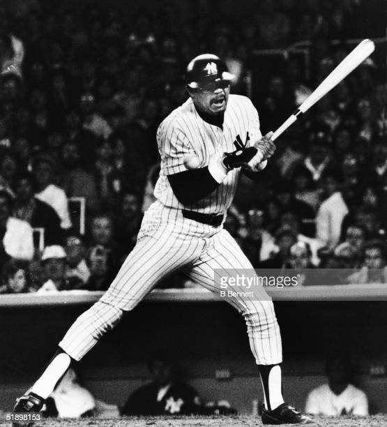 American baseball player Reggie Jackson outfielder for the New York Yankees winces in pain as a ball bounces off of his elbow during a World Series...