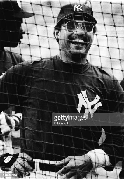 American baseball player Reggie Jackson outfielder for the New York Yankees is all smiles as he jokes with his teammates during batting practice at...