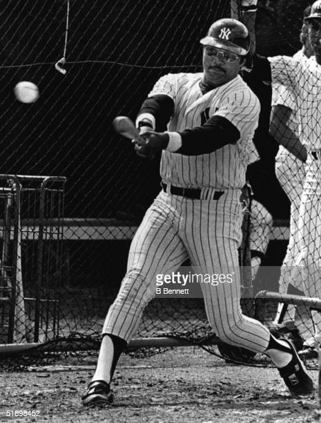 American baseball player Reggie Jackson outfielder for the New York Yankees practices in the batting cage during a spring training workout Fort...