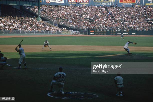 American baseball player Roger Maris right fielder of the New York Yankees stands at home plate ready for a pitch from Sandy Koufax of the Los...