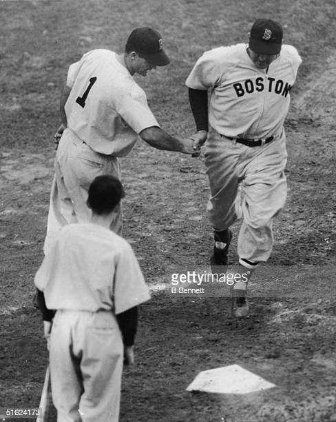 American baseball player Rudy York in the uniform of the Boston Red Sox crosses home plate after hitting the winning run in the tenth inning of the...