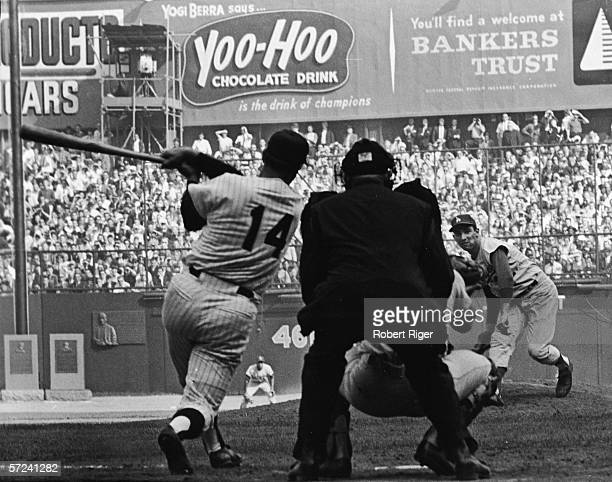 American baseball player Sandy Koufax of the Los Angeles Dodgers pitches to Harry Bright of the New York Yankees in the 9th inning of the first game...