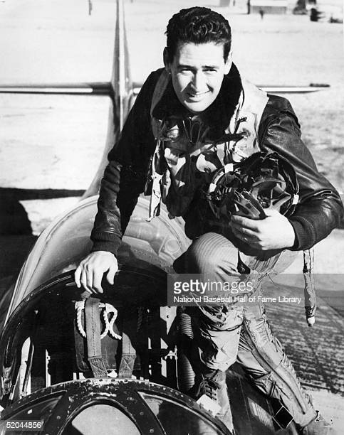 American baseball player Ted Williams #9 of the Boston Red Sox poses in the cockpit of a Grumman F9F6 Panther jet fighter during his service as a US...