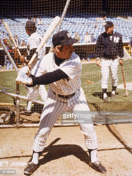 American baseball player Thurman Munson catcher for the New York Yankees holds a bat as he waits for a pitch during batting practice New York New...