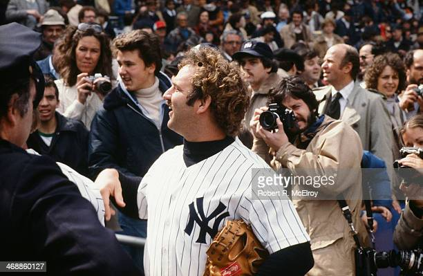 American baseball player Thurman Munson , catcher for the New York Yankees, talks with fans in the stands at Yankee Stadium, New York, New York,...