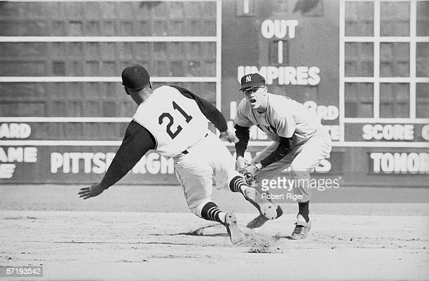 American baseball player Tony Kubek of the New York Yankees tags out Puerto Rican player Roberto Clemente of the Pittsburgh Pirates during game one...