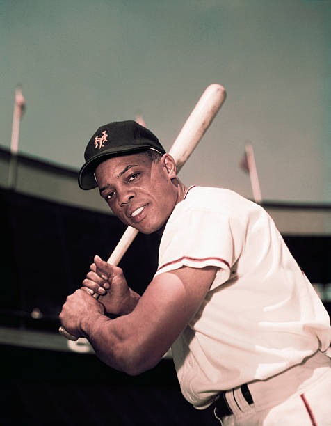 American baseball player Willie Mays of the New York Giants holds his bat, here in this three-quarters length photo, .