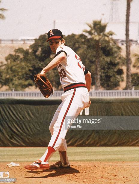 American baseball player with the California Angels Nolan Ryan winds up on the pitcher's mound during practice 1970s