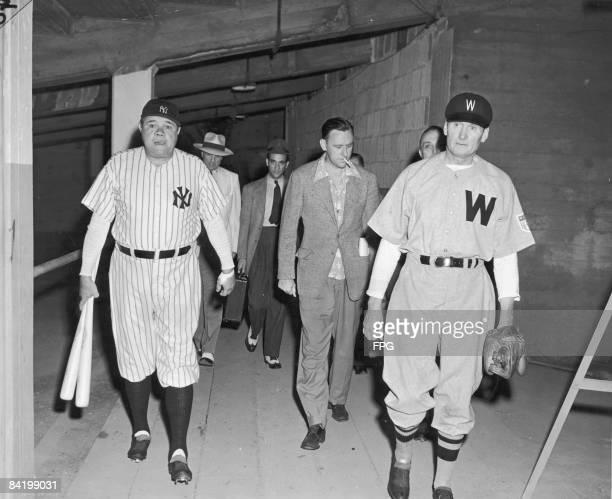 American baseball players Babe Ruth in his former New York Yankees uniform and Walter Johnson in his former Washington Senators uniform head towards...