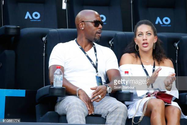 American baseballer Jimmy Rollins and his wife Johari Smith watch the women's singles final between Caroline Wozniacki of Denmark and Simona Halep of...