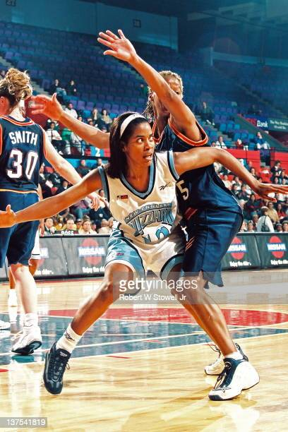 American Basketball League's Carolyn Jones of the New England Blizzard posts up Nikki McCray of the Columbus Quest Springfield MA 1997