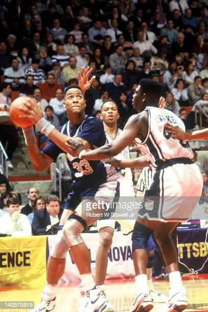 American basketball player Alonzo Mourning of Georgetown University holds the ball as he looks for a shot during a game against the University of...