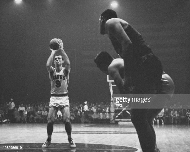 American basketball player Bob Pettit, #9 for St Louis Hawks free throws during a match, St Louis, Missouri, US, circa 1960.