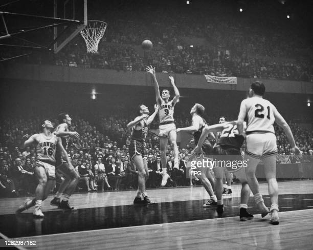 American basketball player Bob Pettit, #9 for St Louis Hawks , in action during a game against Boston Celtics, US circa 1957.