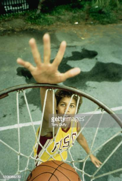 American basketball player Cheryl Miller of USC Trojans, performing a slam dunk, October 1983.