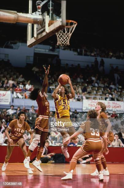 American basketball player Cheryl Miller of USC Trojans takes a shot during a match against the Texas Longhorns, at USC, Los Angeles, California,...
