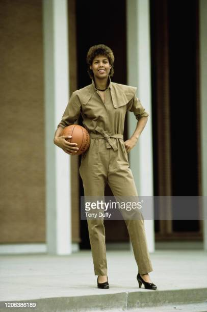 American basketball player Cheryl Miller of USC Trojans, wearing a jumpsuit as she poses with a basketball, October 1983.