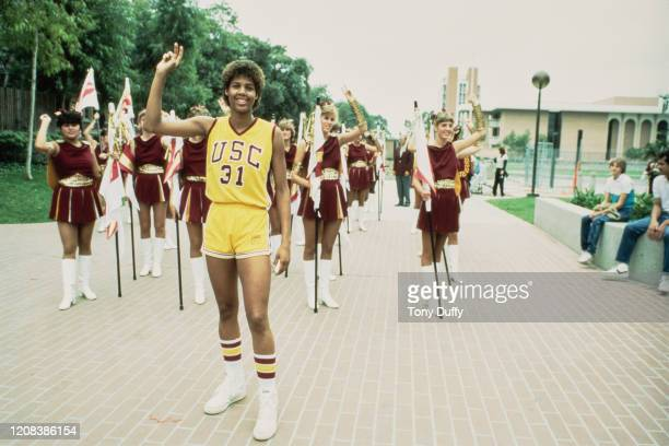 American basketball player Cheryl Miller#31 of USC Trojans followed by a squad of cheerleaders, circa 1984.