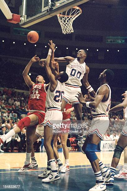 American basketball player Cliff Robinson, of the University of Connecticut, blocks a shot during a game against Ohio State, Hartford Connecticut,...
