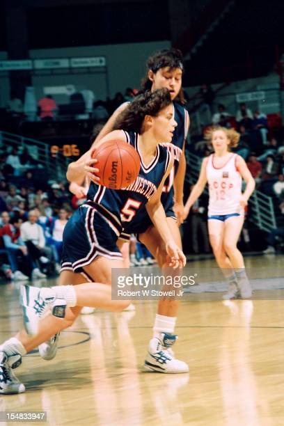 American basketball player Debbie Baer, of the University of Connecticut, dribbles the ball past teammate, Israeli player Orly Grossman, during a...