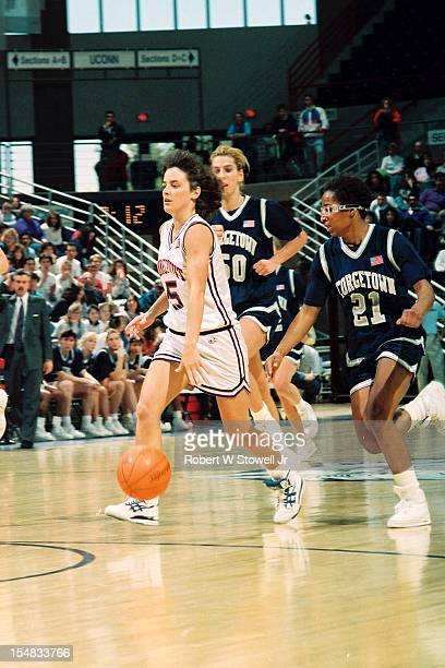 American basketball player Debbie Baer, of the University of Connecticut, looks up court as she dribbles during a game against the Georgetown Hoyas,...
