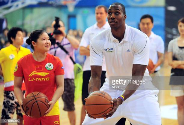 American basketball player Dwight Howard of the Orlando Magic attends the 2010 NBA Teenagers Training Camp activity at Peking University Gymnasium on...